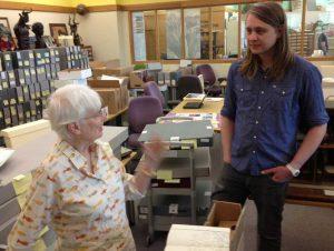 Ariane Dewey in the Kerlan Children's Literature Research Collections Workroom